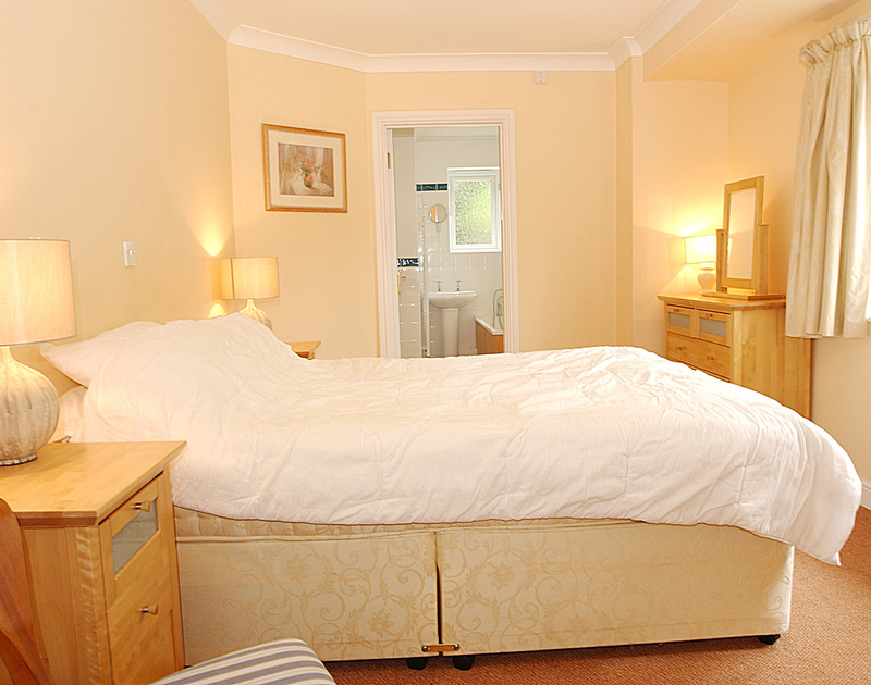 A double bedroom at Thyme Bank, a holiday house at Daymer Bay, Cornwall, with ensuite bathroom.