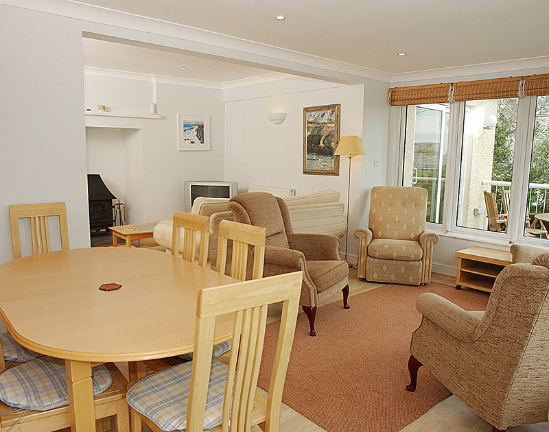 The open-plan dining room/lounge of Thyme Bank, a self-catering holiday house at Daymer Bay, Cornwall