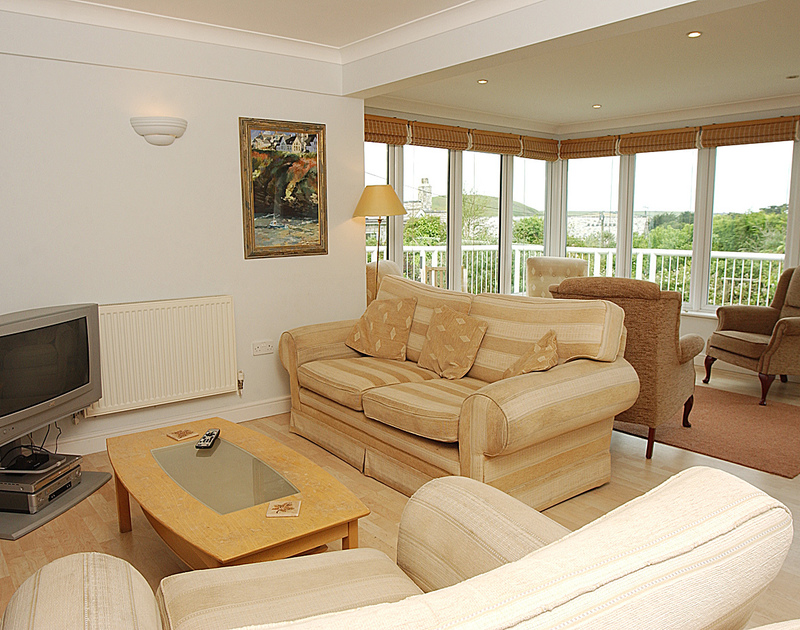 The cosy TV corner of the sitting room of Thyme Bank, a holiday house at Daymer Bay, Cornwall