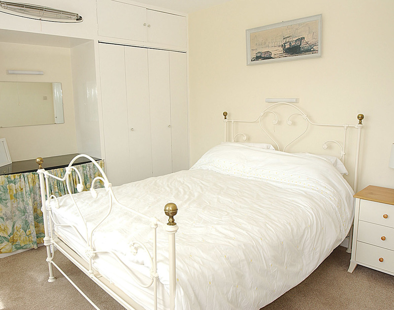 The bright king size bedroom at Sandlings, a self catering, holiday bungalow to rent in Daymer Bay, Cornwall.