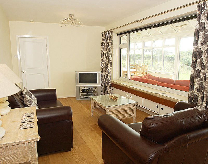 The lounge in self catering holiday bungalow Sandlings set above Daymer Bay on the North Cornish Coast.
