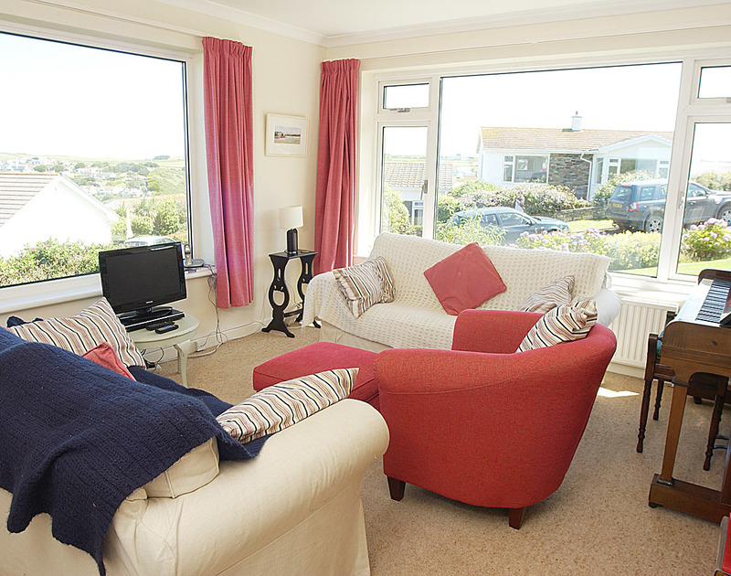 The sitting room and TV in Trewint, a self catering holiday house with wonderful sea views in Polzeath, Cornwall.