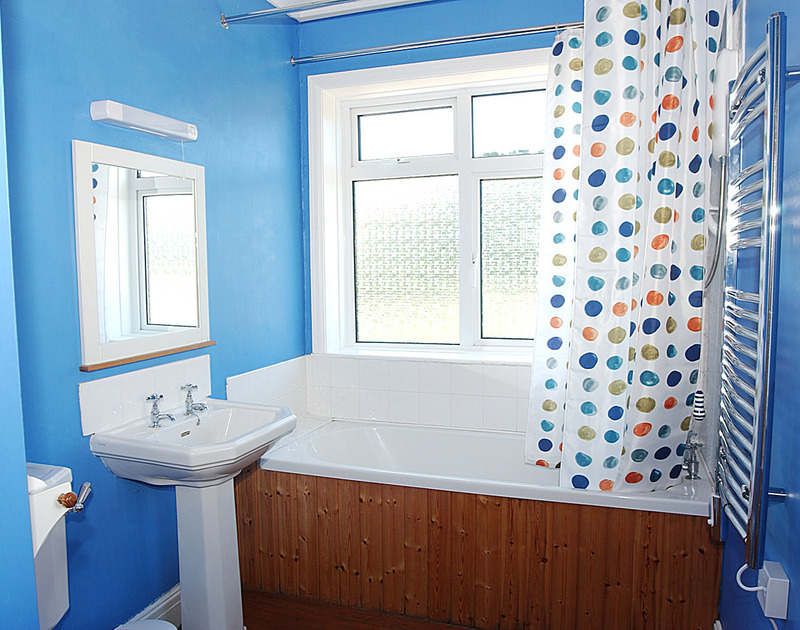 The bright and cheerful bathroom in Burwyn, a self catering holiday house to rent in Polzeath, Cornwall.