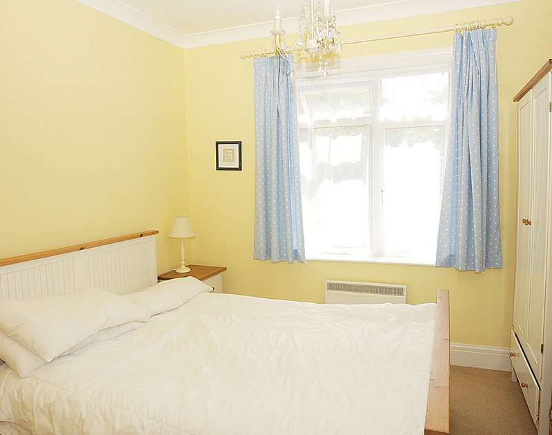 One of two double bedrooms in Burwyn, self catering holiday accommodation by the sea in Polzeath, Cornwall.