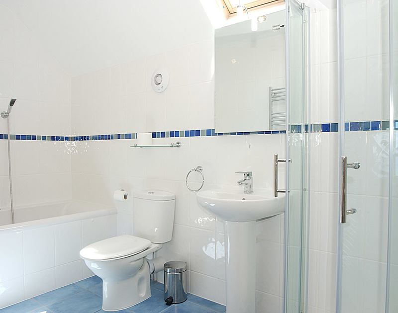 The bright, light bathroom at Treviles, a cliff top, self catering holiday house in Polzeath on the North Cornish Coast.