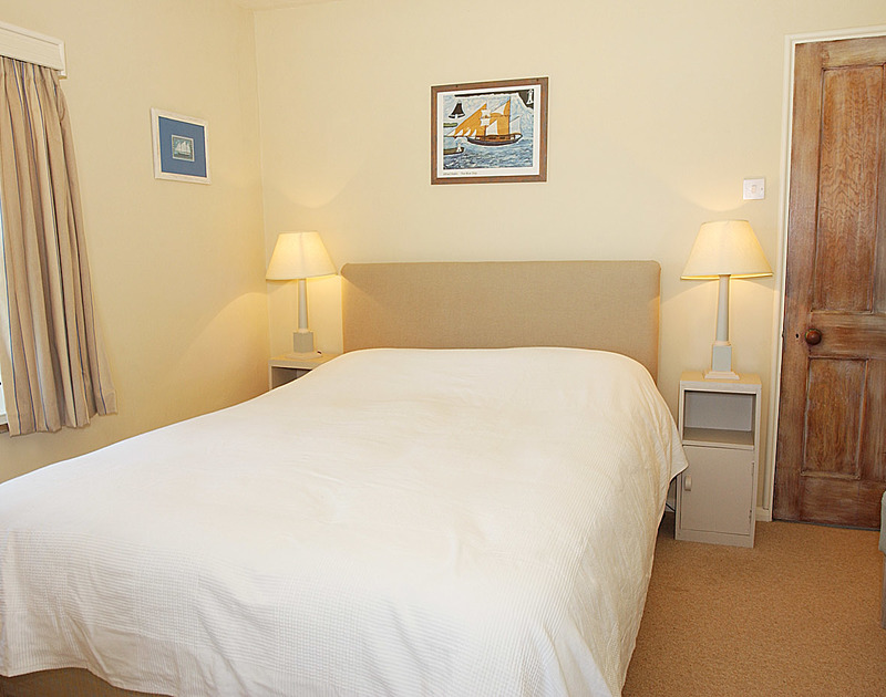 One of the smart, comfortable bedrooms in Treviles, a self catering holiday house set on the cliff top at Polzeath in North Cornwall.