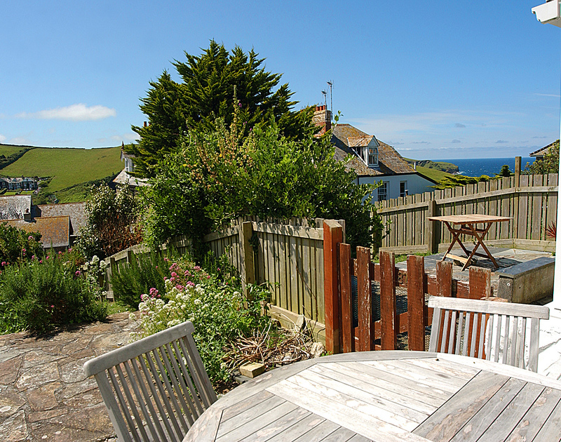 Village and sea views from the patio at Tremanon, a self catering holiday rental in Port Isaac, Cornwall.