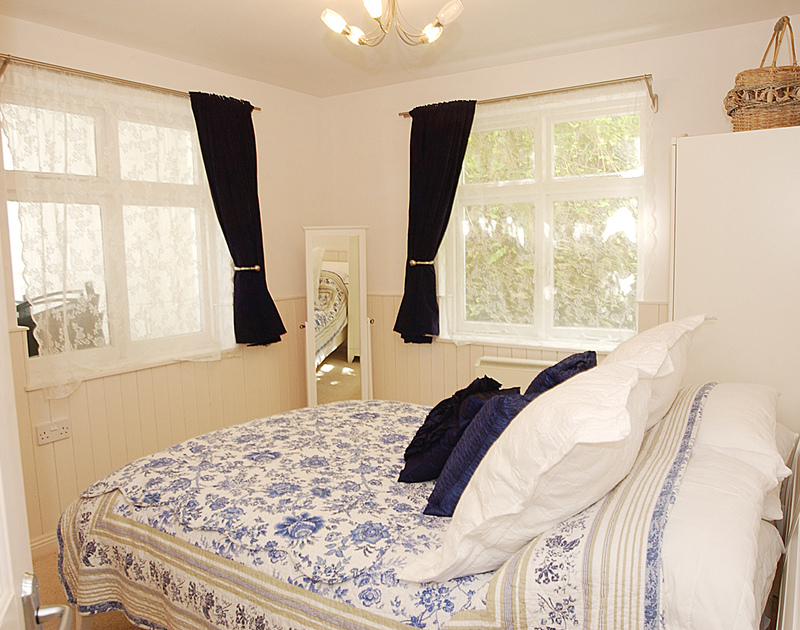 Dual aspect double bedroom in Bosun's Locker, a self catering, romantic holiday retreat in Port Isaac, Cornwall.