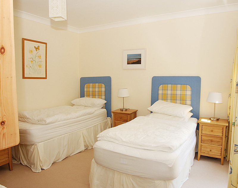 The twin bedroom at Bodare 2 self catering holiday home in Daymer Bay in North Cornwall.