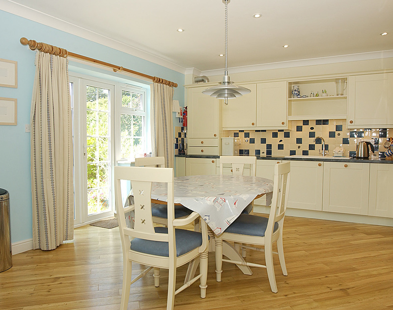 The open plan kitchen and dining room at Bodare 2 self catering holiday home in Daymer Bay North Cornwall.