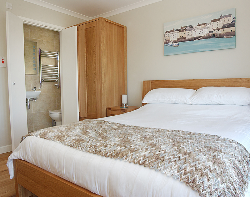Double bedroom with ensuite shower room at Pebblestones, a splendid holiday cottage in Port Isaac, Cornwall.