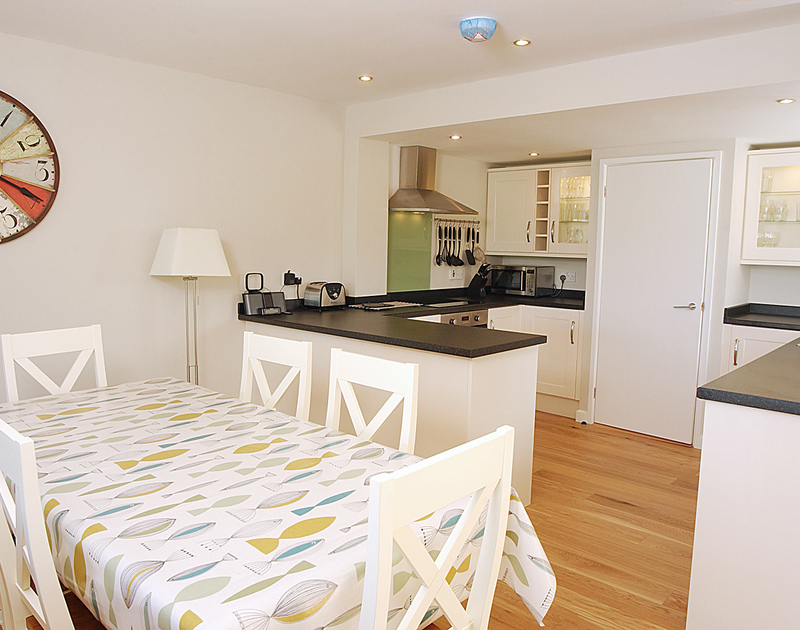 The open-plan kitchen/diner at Pebblestones, a self-catering holiday cottage in Port Isaac, Cornwall