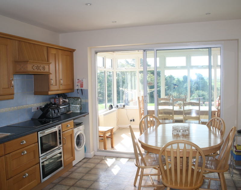 The bright, light open plan kitchen/dining room in Sandlings, a self catering holiday house in Daymer Bay, Cornwall.