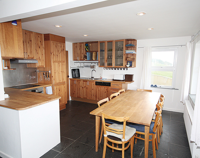 Wood and slate adorn this spacious kitchen at Upper Gren, a holiday house near Daymer Bay, Cornwall
