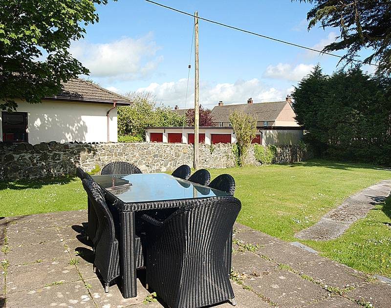 The patio and sheltered garden at Musters, a holiday rental in Rock on the north coast of COonwall.