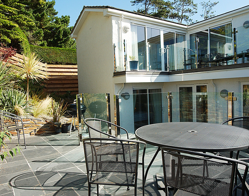 The sunny terrace with BBQ at Lyonesse, Rock in Cornwall is perfect for alfresco meals