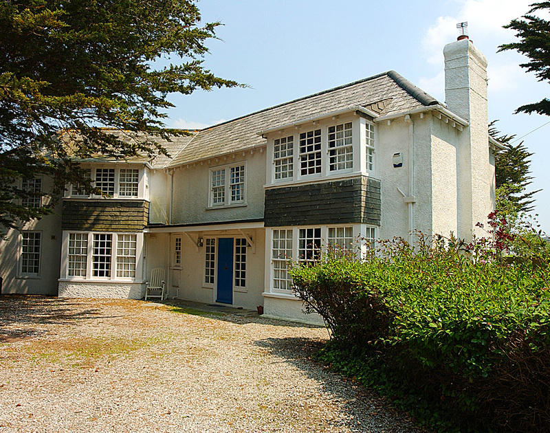 The exterior view of Trewiston Cottage, a traditional holiday house at Daymer Bay, Cornwall