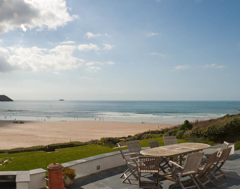 Stunning sea and beach views from the slate paved terrace at Treverden, a large, family sized self catering holiday house to rent in New Polzeath, North Cornwall.
