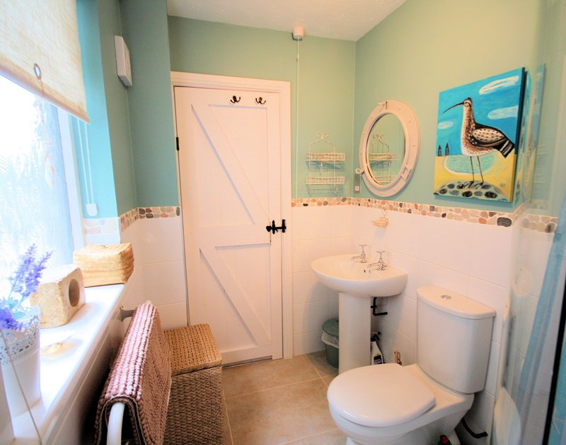The shower room of Rocklings, a holiday house to rent in Rock, Cornwall, with nautical decorations.