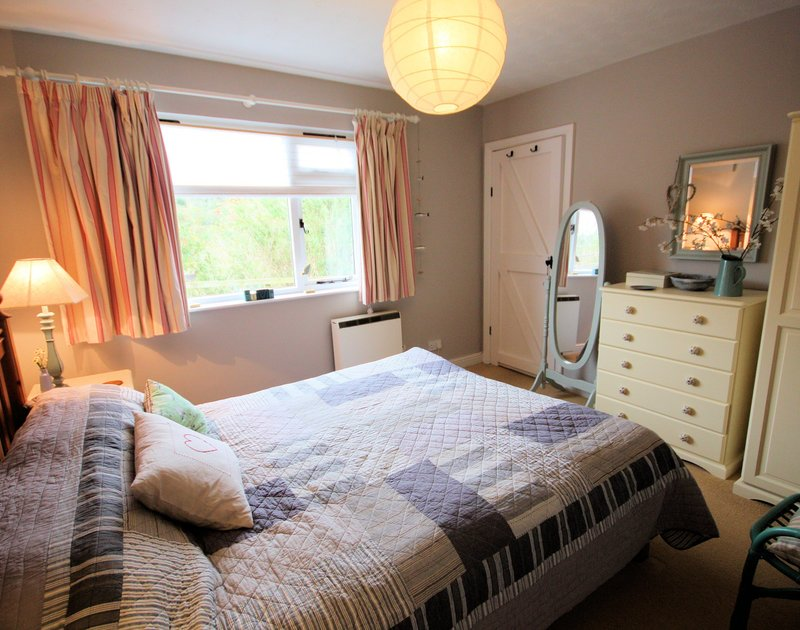 A cosy, attractive double bedroom of Rocklings, a holiday house to rent at Rock, Cornwall
