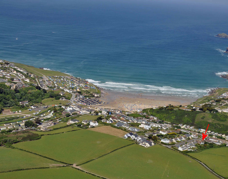 An aerial view with a red arrow showing the position of Little Belz, a holiday house to rent near Polzeath beach, Cornwall.