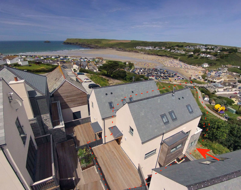An aerial view of the rear of Kellan, a self-catering holiday house in Polzeath, Cornwall, as indicated by red dotted line.