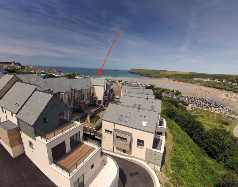 An aerial view of Carnweather, a self catering holiday rental with sea and beach views in Polzeath, Cornwall.