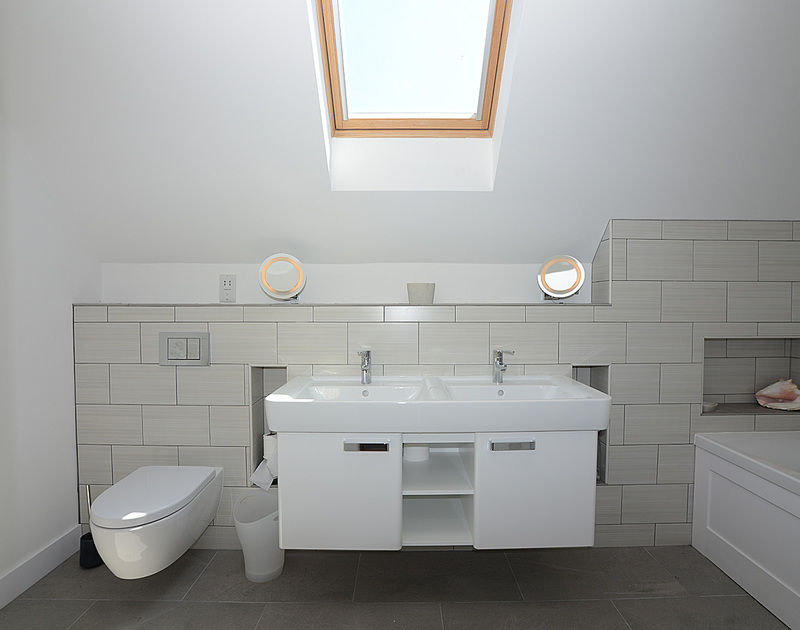 Smart contemporary styling in this master ensuite bathroom at Kellan, a stunning holiday house in Polzeath, Cornwall