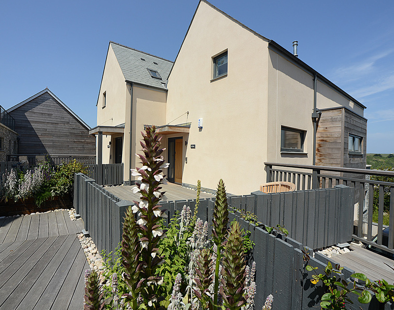 Follow the boardwalk to the entrance of Kellan, a holiday house to rent in Polzeath, Cornwall