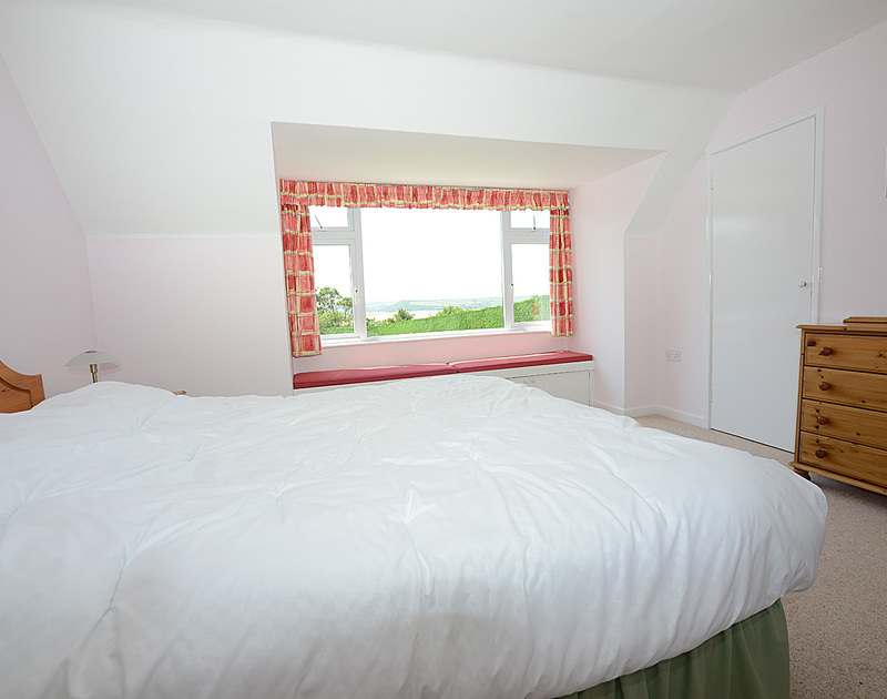 The master bedroom in Tregillan, a self catering holiday house to rent in Rock on the north coast of Cornwall.