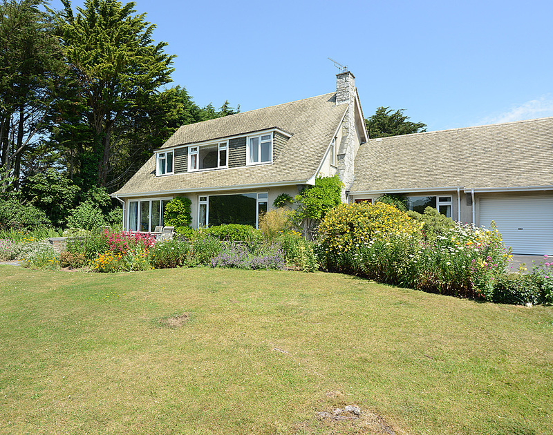 The exterior and pretty garden at Tregillan, a self catering holiday house to rent in Rock, Cornwall.
