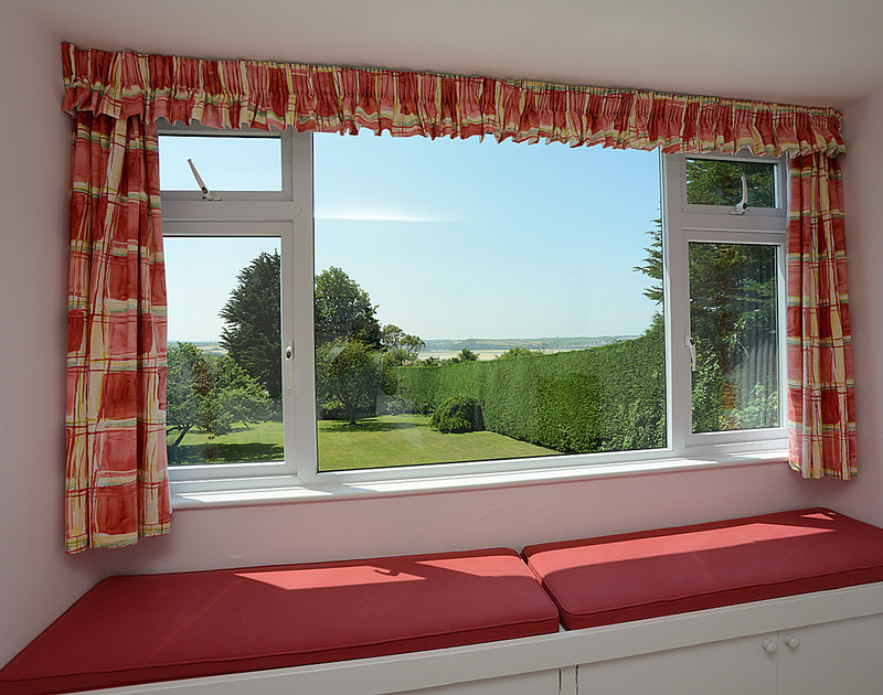 The view from the window seat in the master bedroom at Tregillan, a holiday house to rent in Rock, North Cornwall.