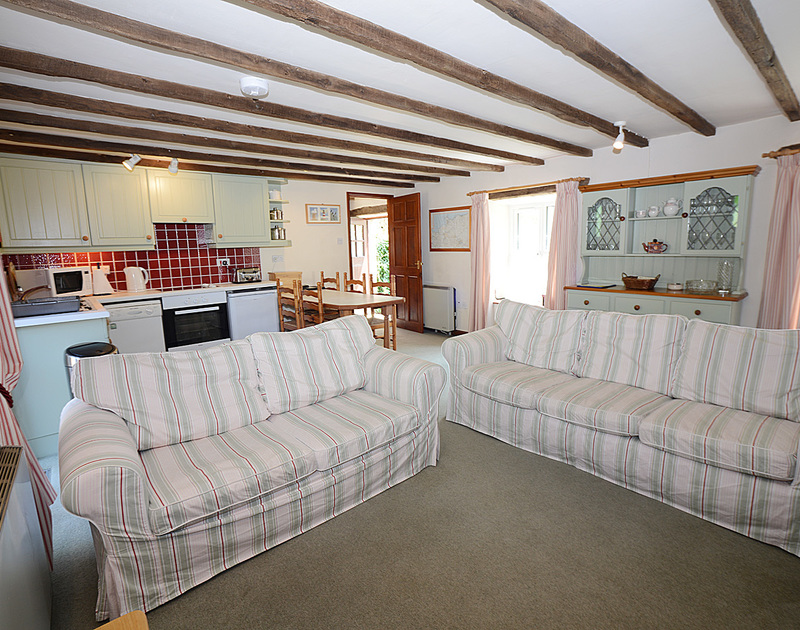 Two comfy sofas in the sitting room in The Granary, a self catering holiday house to rent in Rock, Cornwall.
