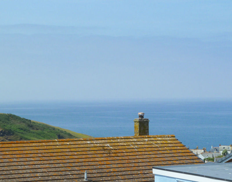 Stunning sea views over the rooftops of Port Isaac's village from Sunnybank, a self catering holiday property in North Cornwall.
