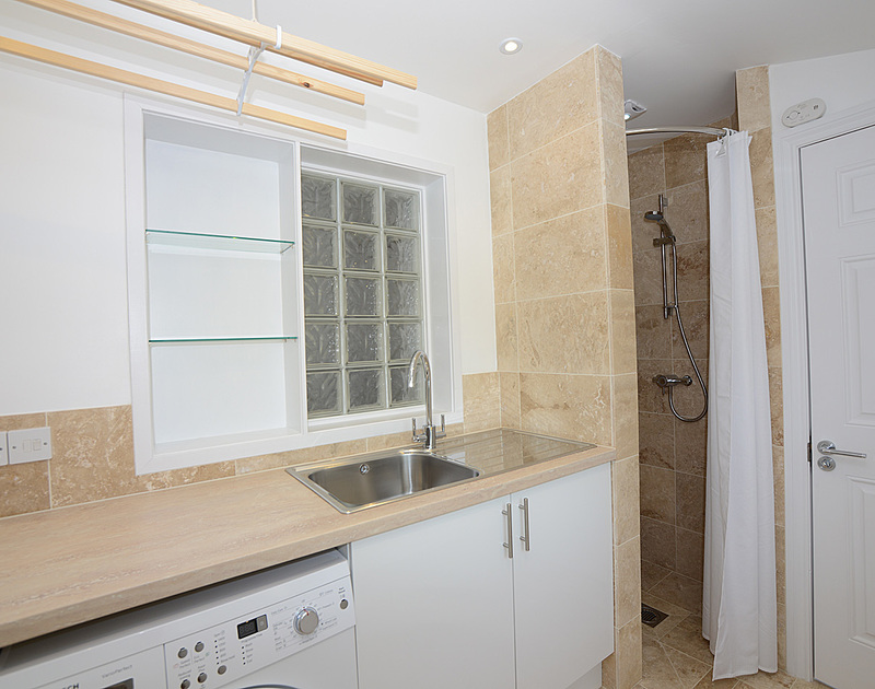 The handy utility room with shower/ wetroom in Lowenna Manor 10, a self catering holiday rental in Rock, Cornwall.
