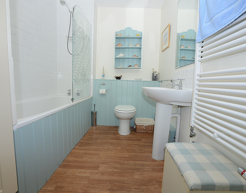 One of two perfectly appointed bathrooms in Slipway 12, a self catering holiday cottage to rent on the Camel Estuary in Rock, North Cornwall.