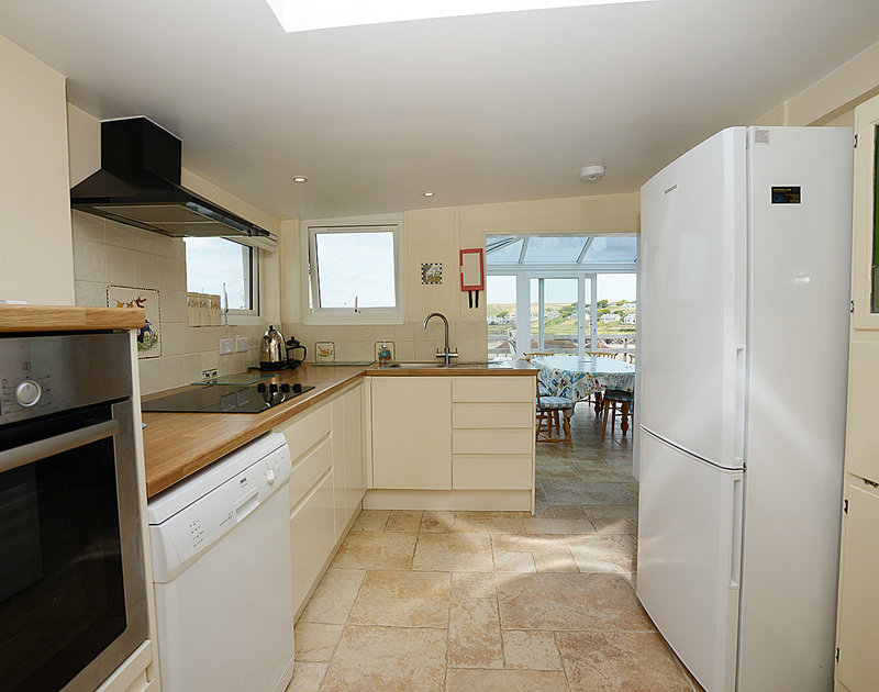 The light and well-equipped kitchen at Malindi, a holiday house to rent at Polzeath, Cornwall