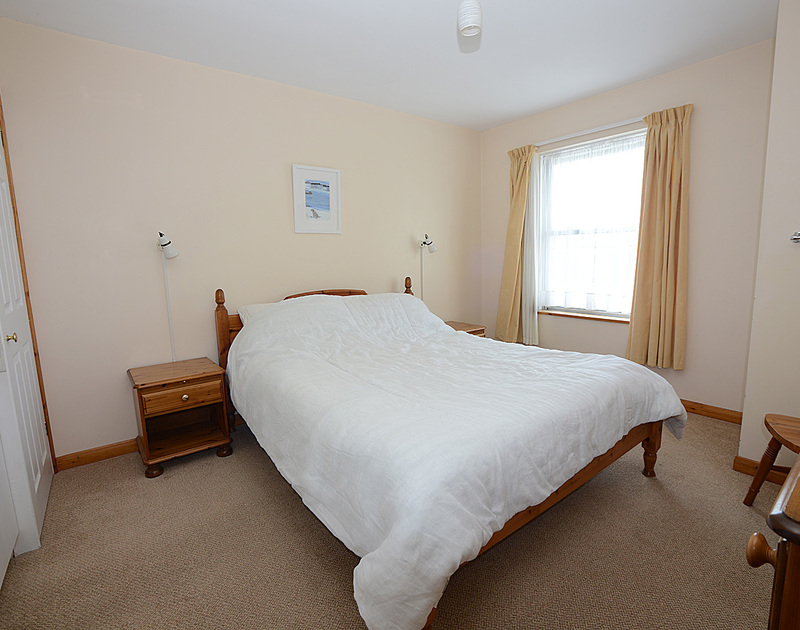 The double bedroom of Slipway 14, holiday rental in Rock, Cornwall, with its kingsize bed.