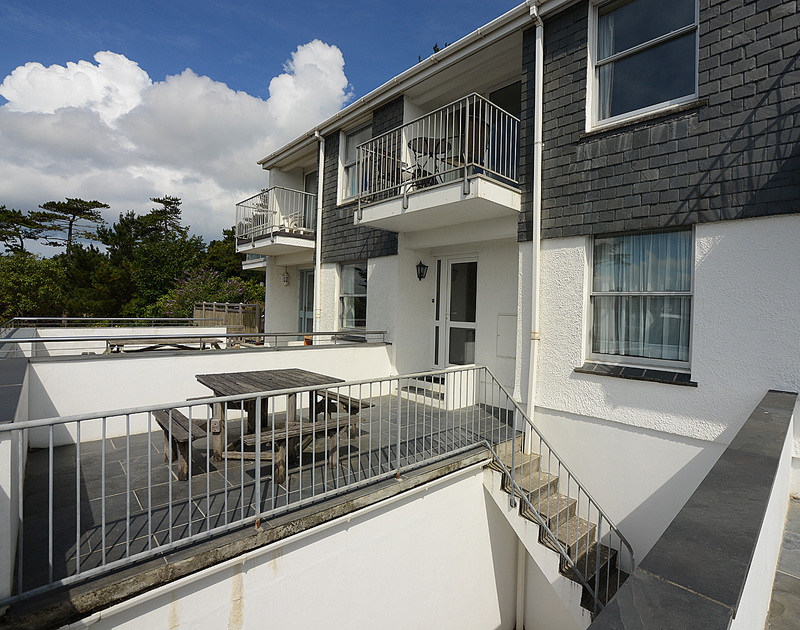 The exterior view of Slipway 14, a holiday rental in Rock, Cornwall, with its elevated patio and balcony.