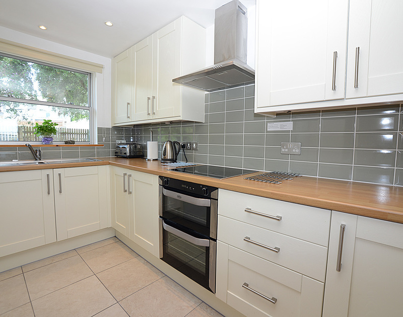 The well-equipped attractive kitchen of Slipway 14, self-catering holiday rental in Rock, Cornwall