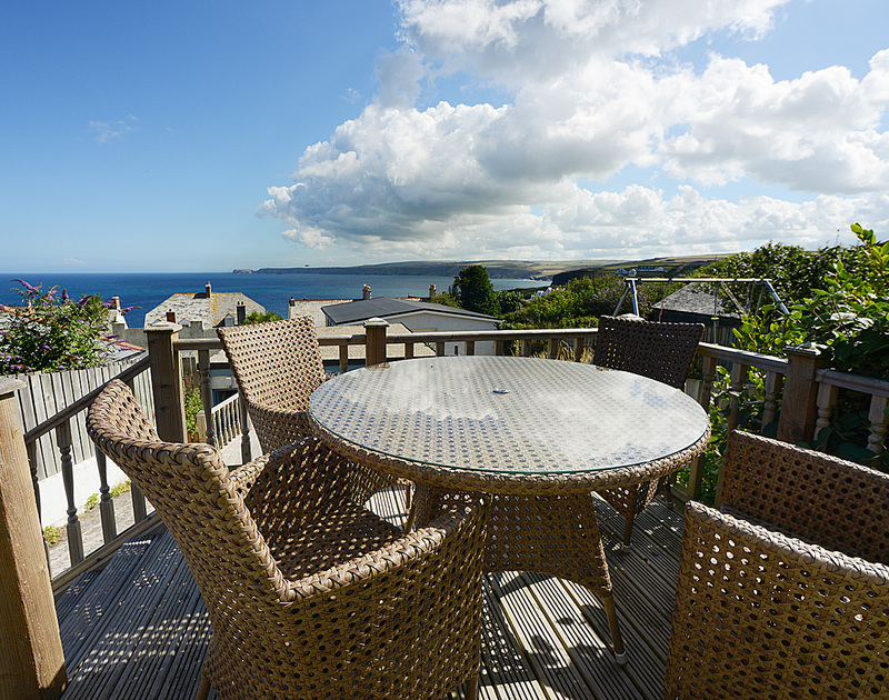 Enjoy glorious sea views from the decked terrace at Merlin's View, Port Isaac holiday house.