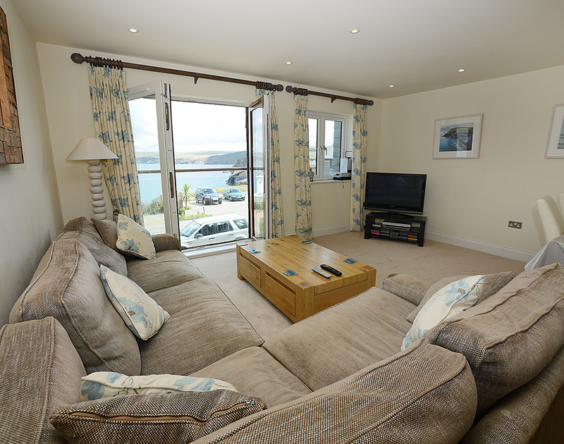 Stunning sea and coastal views from the sitting room in Rock Lobster, a self catering holiday house to rent in Port Isaac, Cornwall.