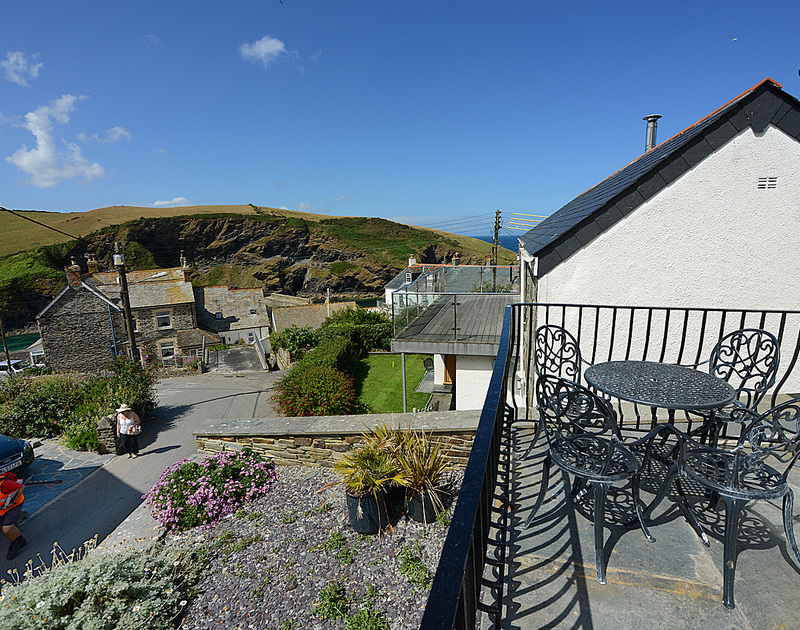 Sunny patio with village and harbour views at Stowaway, a self catering holiday rental in Port Isaac, Cornwall.