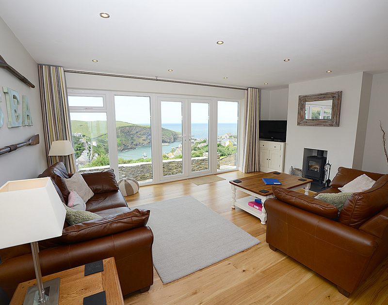 Stunning harbour and sea views from the sitting room of Pebblestones, a holiday cottage in Port Isaac, Cornwall