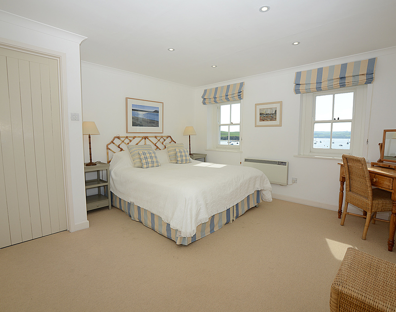 The double bedroom at 2 Quay Cottage, holiday cottage to rent in Rock, with its kingsize bed and lovely river views.