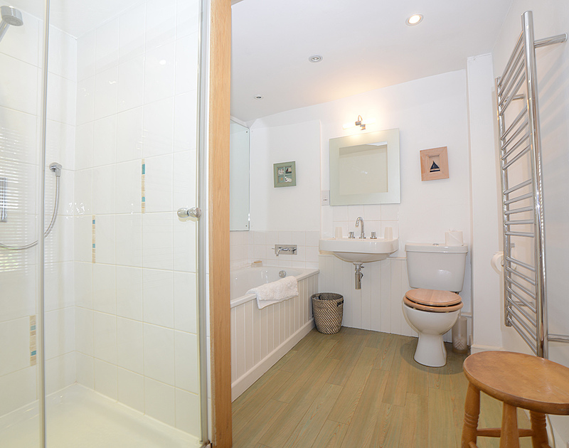 The beautifully finished modern bath and shower room at 2 Quay Cottage, holiday house in Rock, Cornwall