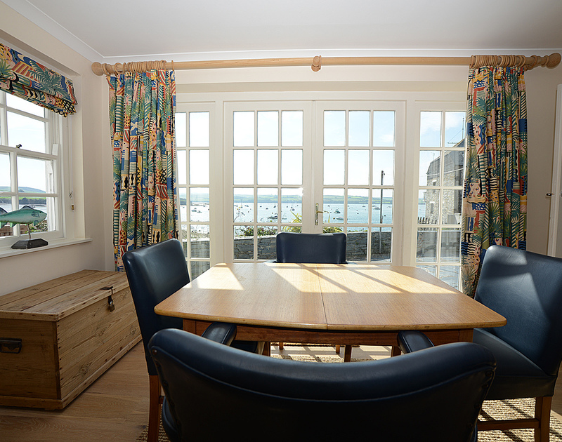 The dining room with its lovely view of the Camel Estuary at 2 Quay Cottage, a well-located holiday cottage to rent at Rock, Cornwall