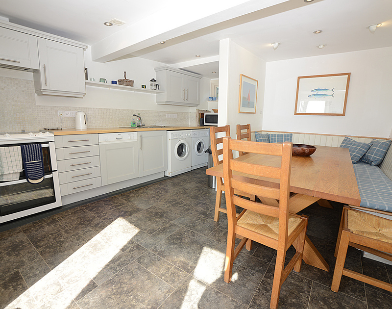 The contemporary kitchen of 2 Quay Cottage, a holiday house on the waterfront at Rock, Cornwall