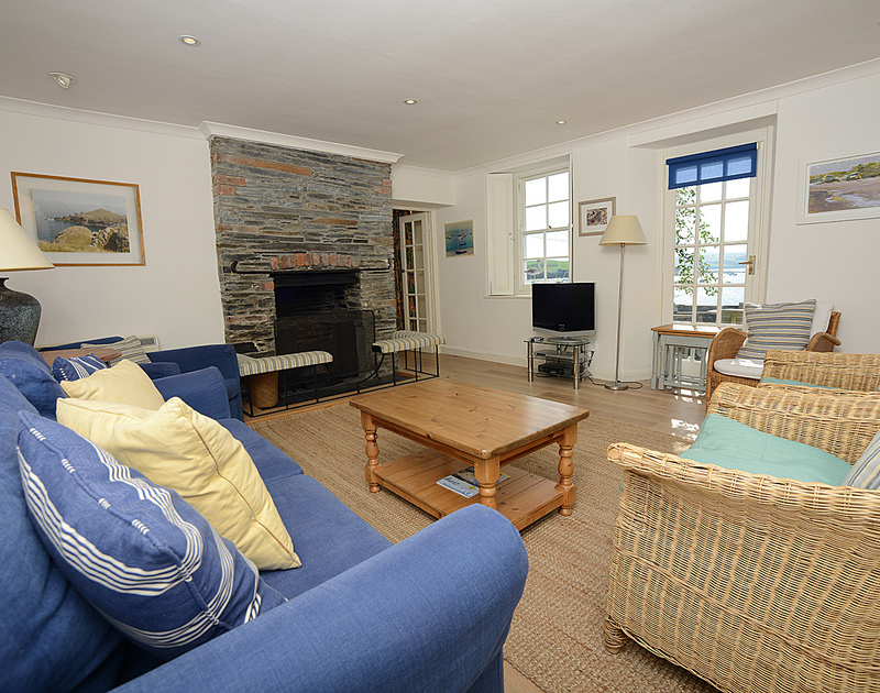 The sitting room with its estuary view at 2 Quay cottage, a charming waterside holiday cottage at Rock, Cornwall