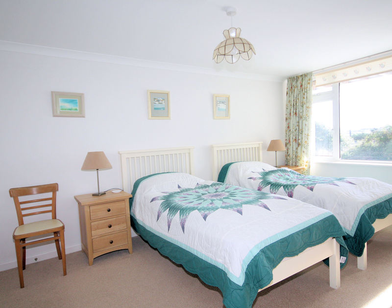 Light and spacious twin bedroom at Higher Crawallis, a well-located holiday rental near Daymer Bay, Cornwall
